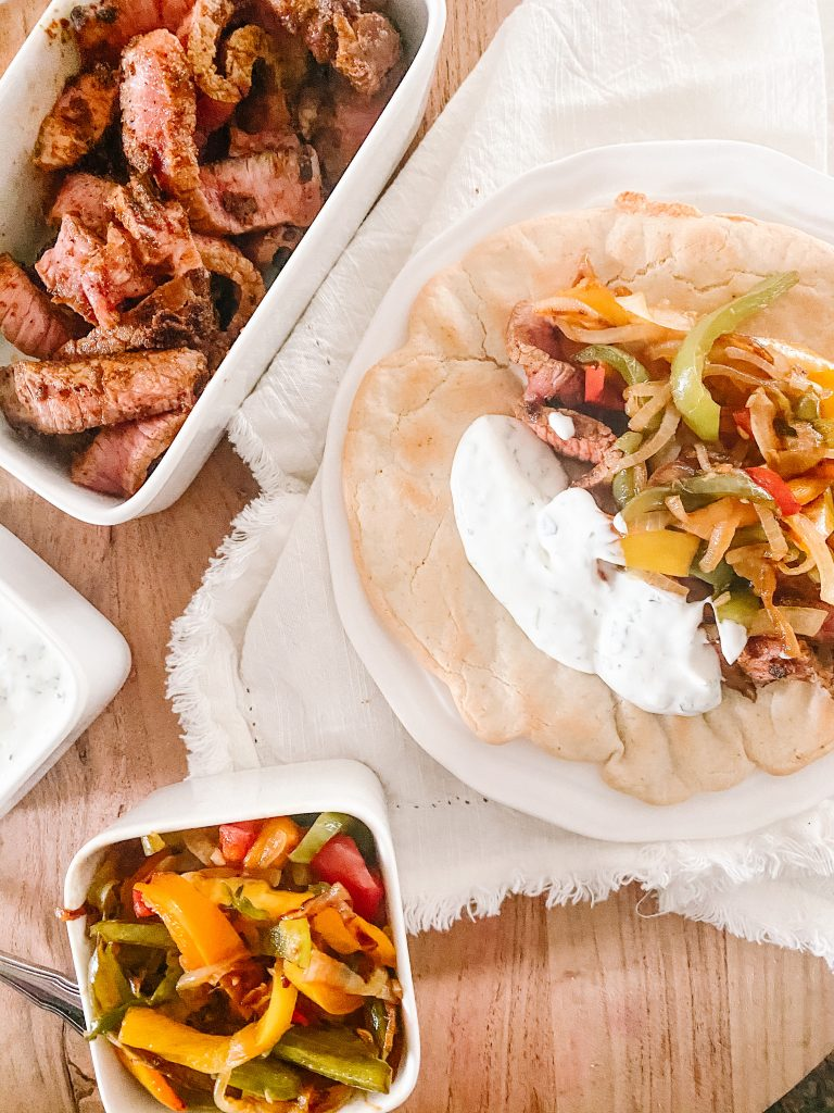 Steak Fajitas with Sautéed Bell Peppers with Lime Crema on Naan